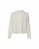 IN JEST: Cream multi-cable sweater with shoulder buttons