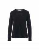 IMAGINATIVE: Black flared sweater with inverted V inset