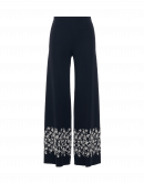 GRAVITATE: Wide leg pants in navy tech jersey with ivory embroidery