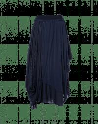 TUMBLING: Asymmetrically draped plain and pinstripe skirt