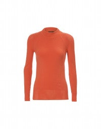 GLOW: Coral sports style tech knit turtleneck
