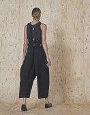 DIVISION: Pantaloni ampi con zip decentrata e bretelle