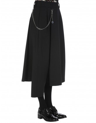 CONCEIT: Asymmetric pant in black wool with stretch