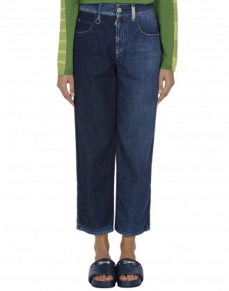 INTRIGUE: Easy fit, asymmetrically faded jeans