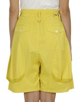 SCANTY: Yellow cotton and linen 4 pleats shorts