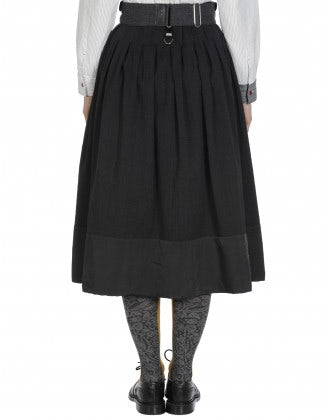 REVOLVE: Full, pleated skirt in dark grey with polka dot hem