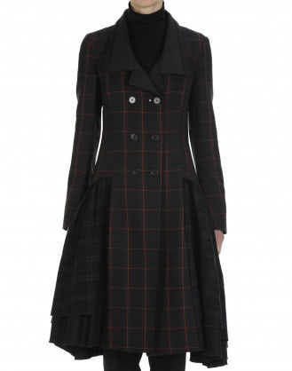 PROUD: Black, green and red check full skirted coat