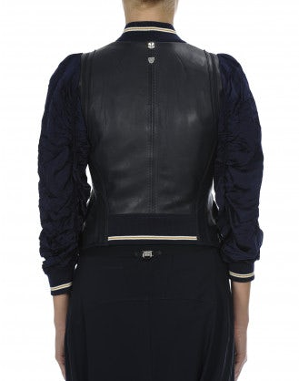 JUBILANT: Navy short jacket in leather and cupro