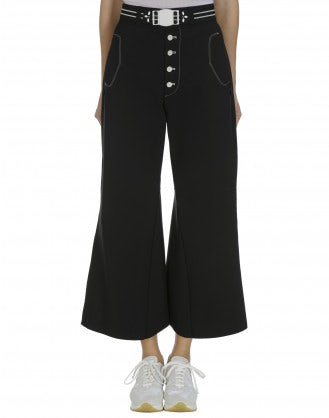 YEARN: Black front flares with buttoned fly