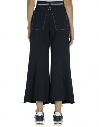 YEARN: Navy front flares with buttoned fly