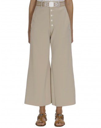 YEARN: Beige flares with buttoned fly
