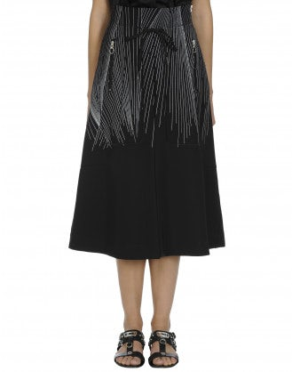 MODESTY: Black A-line skirt with white stripe print