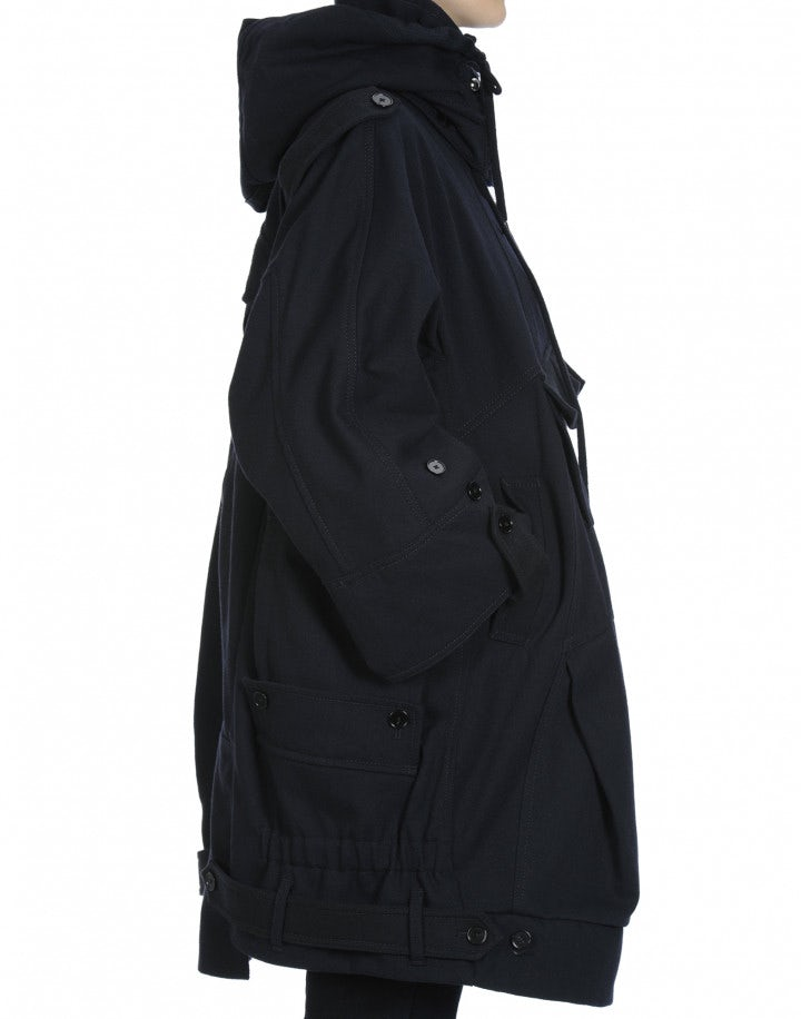 QUIRKY: Multi-pocket, multi-seam parka in navy wool blend
