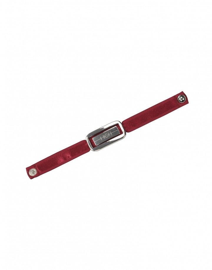 ACCENT: Bracciale con placchetta logata in metallo e nastro rosso